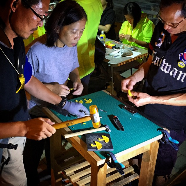 So what do you do at protests? #leatherwork of course. Some #artisans making #leather #umbrellas embossed with #love and #peace on them. The next table over, another artisan is making a pendant out of them. #OccupyHK #umbrellarevolution #HongKong #hk #hkig
