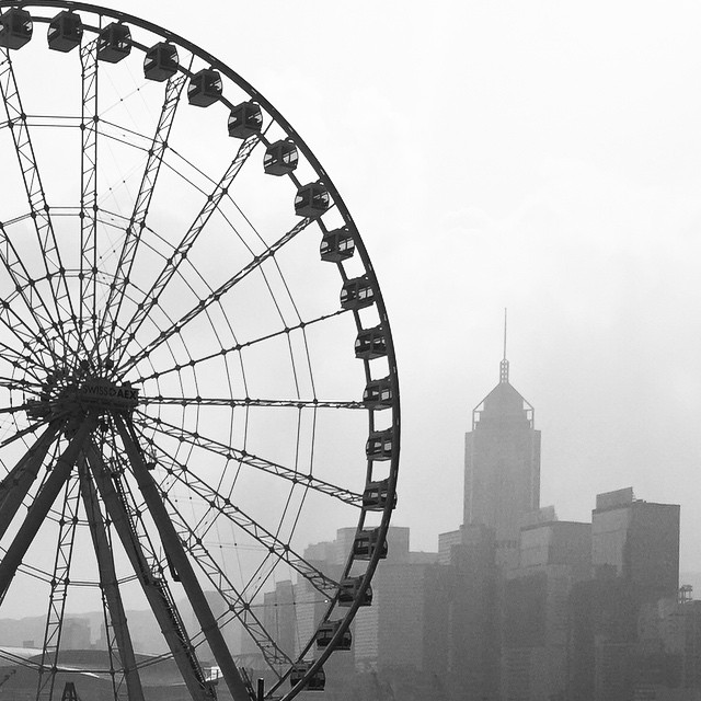 The, as of yet, incomplete #FerrisWheel at Central overlooks a #hazy #Sunday #morning in #HongKong. #HK #hkig #mono