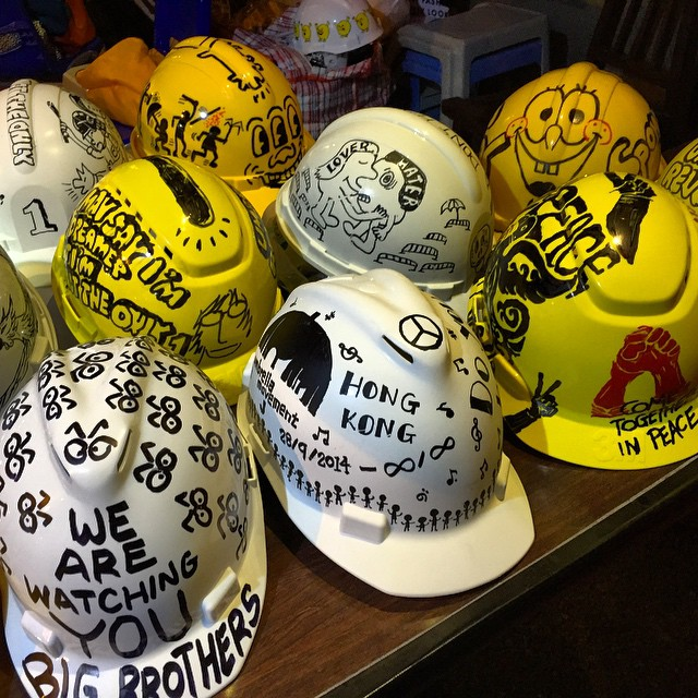 The #hardhats of the #umbrellarevolution. Just because you gotta be safe doesn't mean you can't get creative about it. #OccupyHK #hardhat #HongKong #hk #hkig