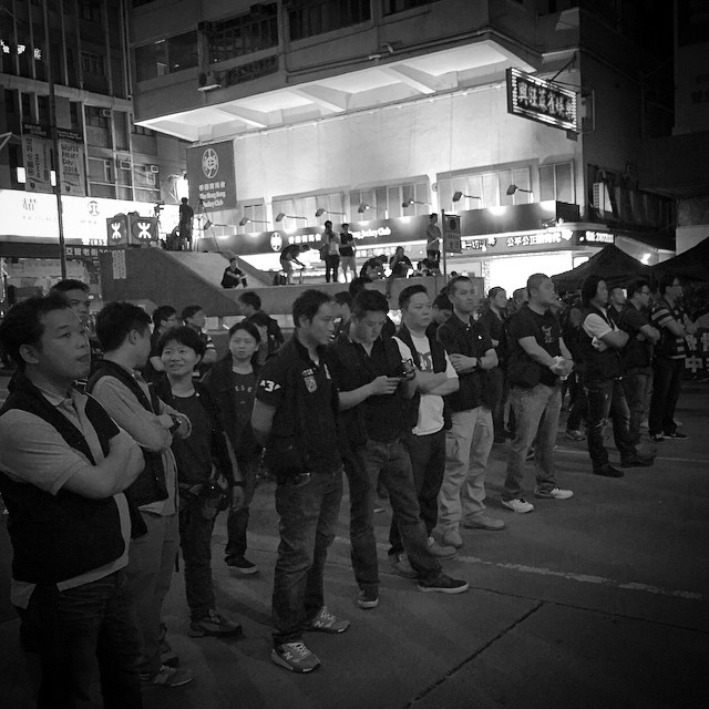 These are not #OccupyHK protesters holding the line at #Mongkok, they're plain clothes #police that are now wearing their police jackets. This raises the question, were they hidden in the crowd all along? #mono #hk #hkig #HongKong