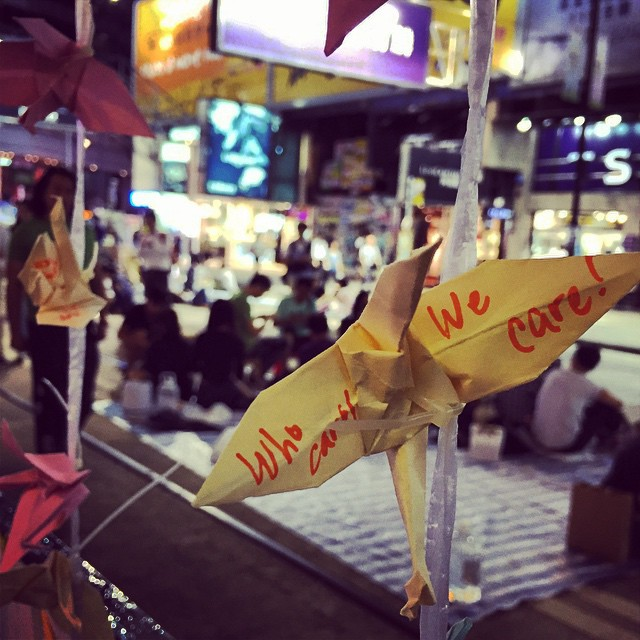 Who cares? We care! Hundreds of #papercranes, all with messages on them are strung up along the #OccupyHK site in #CausewayBay. #HongKong #hk #hkig