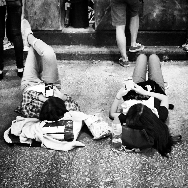 #legs up - there's always time to layback and check your #smartphone... even if in the middle of #NathanRoad in #Mongkok during #OccupyHK. #mono #HongKong #hk #hkig