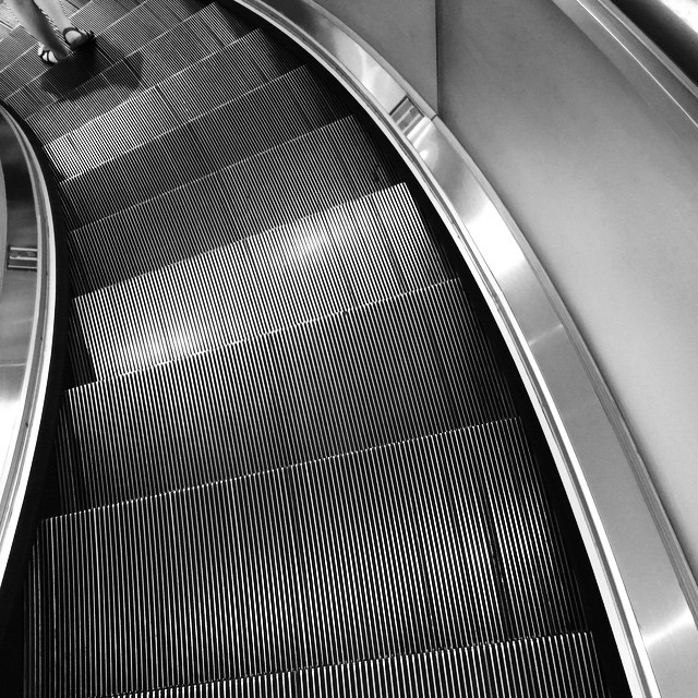 #texture, #curves and #feet - a curving #escalator. #mono #HongKong #hk #hkig