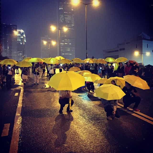 A live #OccupyHK #art installation on #HarcourtRoad at #Admiralty. Protesters with yellow #umbrellas form the shape of a big #umbrella (visible from above). Well kinda appropriate since it's a #rainy night and all. #HongKong #hk #hkig