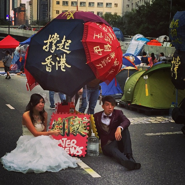 A new generation of #HongKong is emerging - one that's political enough to take their #wedding photos at #OccupyHK #Admiralty. #HK #hkig
