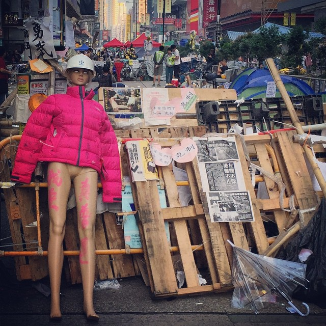 Bye bye #barricade? It's clearout day at #OccupyHK #Mongkok. #barricades like these on #NathanRoad will be cleared to restore traffic flow. Guess the #mannequin will have to find a new job. Back to the store window perhaps? #HongKong #hkig #hk