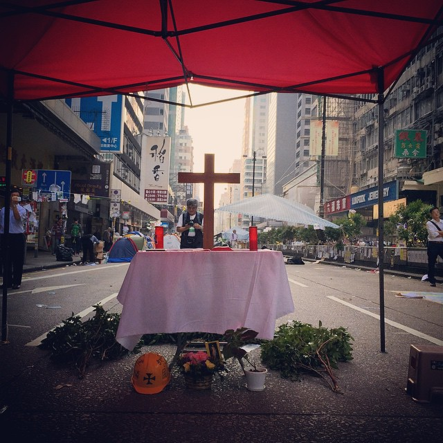 Last call at the #Jesus #Shrine ( #Chapel of St. Francis, anyone?) on #NathanRoad at #OccupyHK #Mongkok. The shrine has been cleared in anticipation of the unrest the clearouts will cause today. All that's left is the table and the #cross. #HongKong #hk #hkig