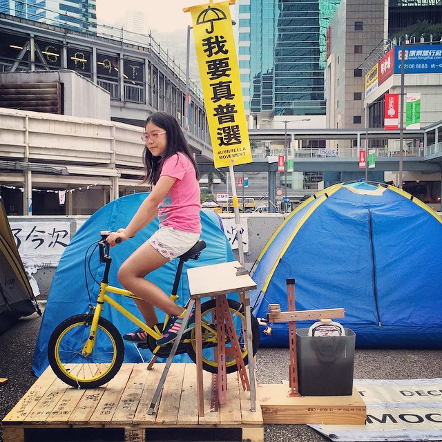 More installation #protest #art at #OccupyHK #Admiralty - as you pedal the #bicycle, the wooden arm attached to the back wheel goes up and down and whacks #689 on the head. #HongKong #hk #hkig