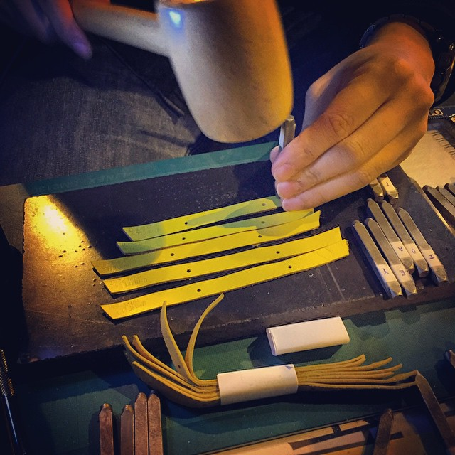 Personalised #OccupyHK #leather #yellowribbons being made. Your name is hammered into the leather using the tools. #HongKong #hk #hkig