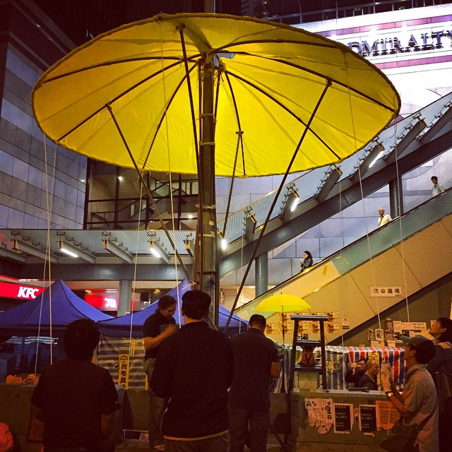 Raise the #YellowUmbrella - ok, so it's not Raise the Red Lantern. A giant yellow #umbrella structure being constructed from a lamppost at #OccupyHK #Admiralty. #HongKong #hk #hkig