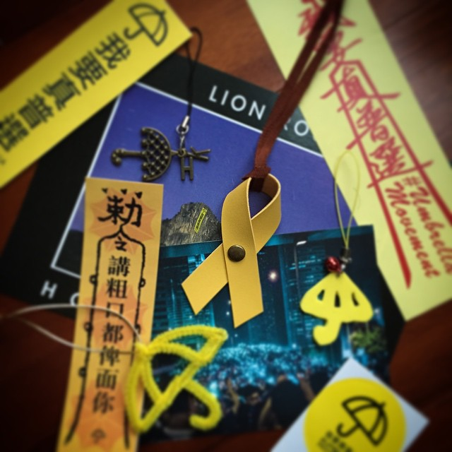 Revolutionary #symbols? A small selection of the creativity of Occupy #HK. The #UmbrellaMovement or #umbrellarevolution or #OccupyHK or #OccupyCentral (whichever you choose to call it) has spawned an outpouring of creativity from the citizens of #HongKong. Each incident has spawned some sort of symbol that has then been seized upon. Teargas made the humble #umbrella a symbol. Originally an Internet profile thing, the #yellowribbon has become a physical symbol, the Lion Rock banner has kicked off many other similar banners. The vivid imagery of the protests has been made into posters and #postcards... and these are the small things. Large art installations come and go at the protest sites. Hong Kong isn't just home to commerce, it's home to a great deal of creativity too. It just hasn't been capitalised on. #hkig