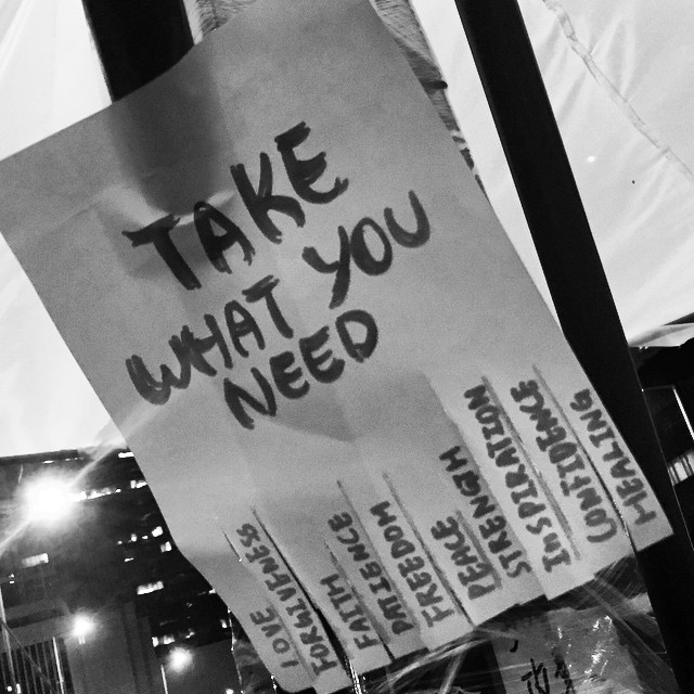Take What You Need - this #OccupyHK #poster looked a little self-serving until I got closer and saw what was written on the little tear-away chits. You should take what you need. #mono #HongKong #hk #hkig