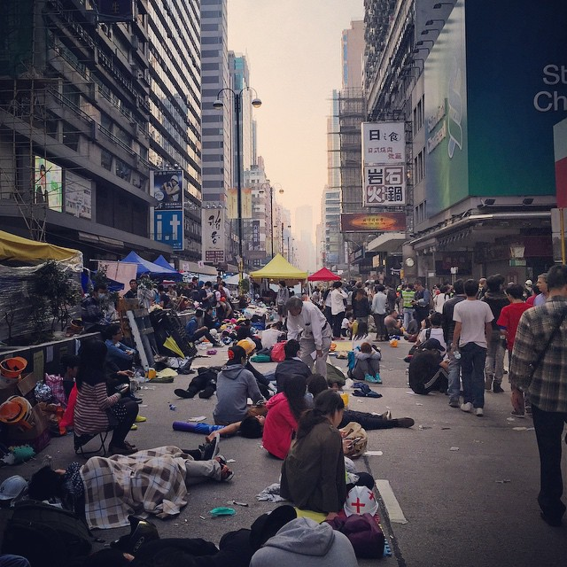 #dawn breaks on a chaotic #NathanRoad in #Mongkok. #OccupyHK #protesters are strewn all over the road just resting from the chaos last night. Then later today, the clearout of Nathan Road will begin. #HongKong #hk #hkig