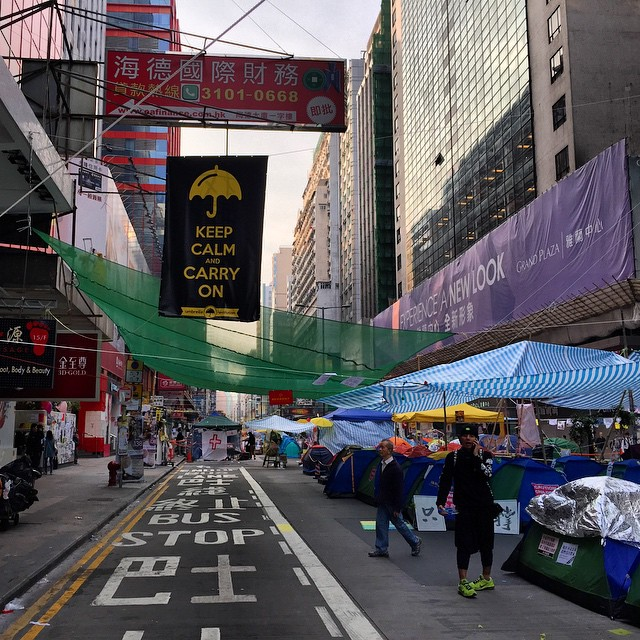 #dawn on the 53rd day of #OccupyHK in #Mongkok. All is calm now on #NathanRoad as the violence was in Admiralty last night but this peaceful scene won't last: police clearouts are scheduled for later today. #HongKong #hk #hkig