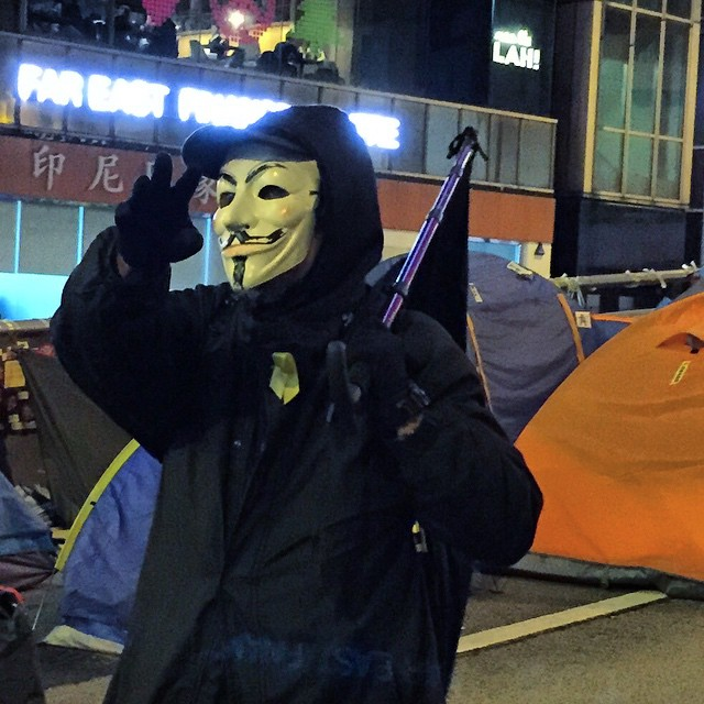 A black-flagged #anonymous #GuyFawkes speaks at #OccupyHK #Admiralty. #HongKong #hk #hkig