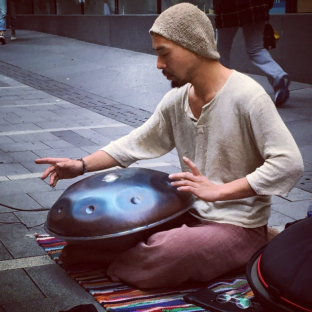 A #street #musician playing the #Hang #drum - it's similar to the #calypso #steeldrum and looks like an upside down #wok with bumps on it. #HongKong #hk #hkig #HangDrum