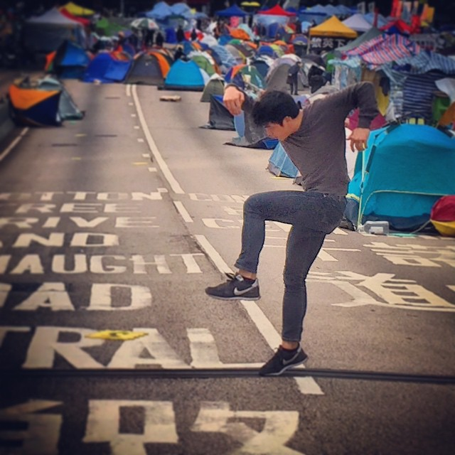 Walking around #OccupyHK #Admiralty and wandered into a guy #dancing what looked to be a wildly energetic #interpretativedance. We're talking Louie Spence kinda #dance here. #HongKong #hk #hkig #art