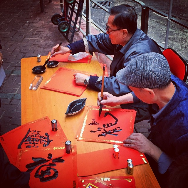 #ChineseNewYear in #hongkong means handwritten #luck and #prosperity signs to be hung on walls. No store bought signs here, get your own custom written by old #calligraphers on the #street. #calligraphy #hk #hkig #CNY2015