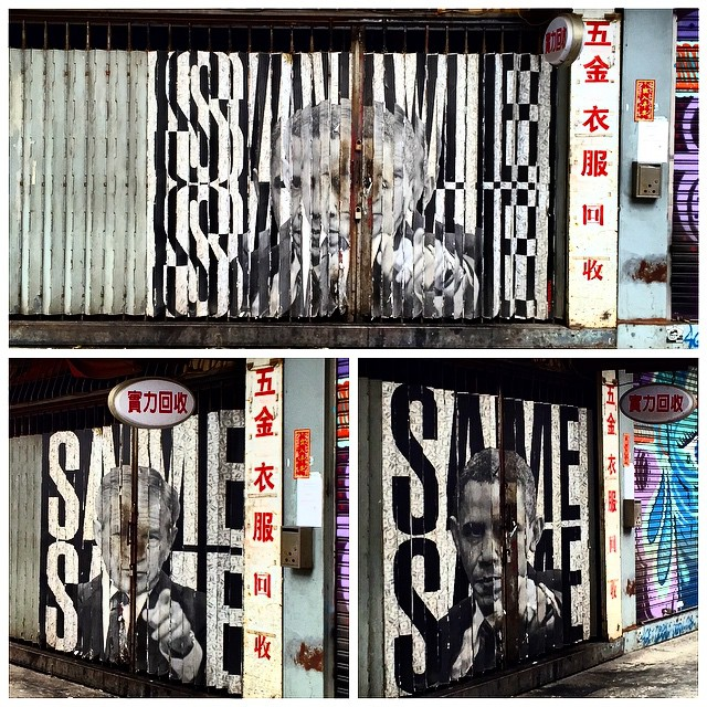 #samesame - a brilliant #metal #shutter #art piece in #TaiKokTsui. The metal shutter is angled; from straight on the piece looks disjointed but if you look from the left it's #Obama, if you look from the right it's #GWBush (nice placement on the left / right too, heh). Both #presidents appear on background of SAME SAME but one is black on white and the other is white on black. #HongKong #hk #hkig #political #graffiti