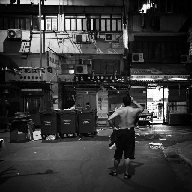 After a hard days work. A #man stands shirtless amongst the closed stalls of a #streetmarket in #Mongkok. #HongKong #hk #hkig