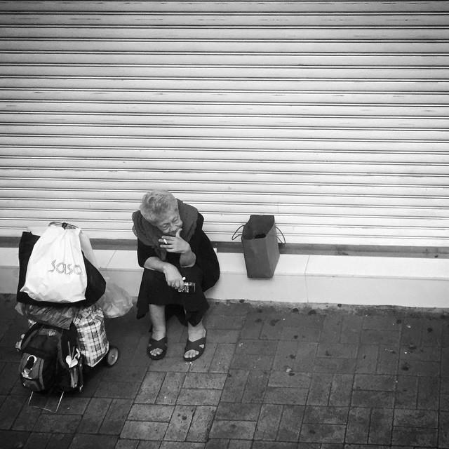 A #lady #smoking a cigarette take a break. #Mongkok #HongKong #hk #hkig #mono