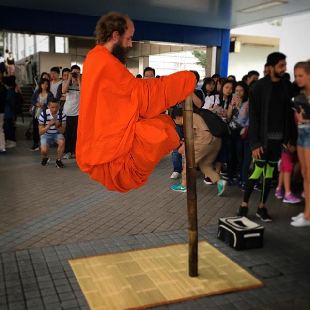 Totally didn't expect to see the #levitating #yogi trick here in #central, #hongkong. I'm sure you all know the trick, right? #HK has its own version in the Cheung Chau bun festival parade. #hkig