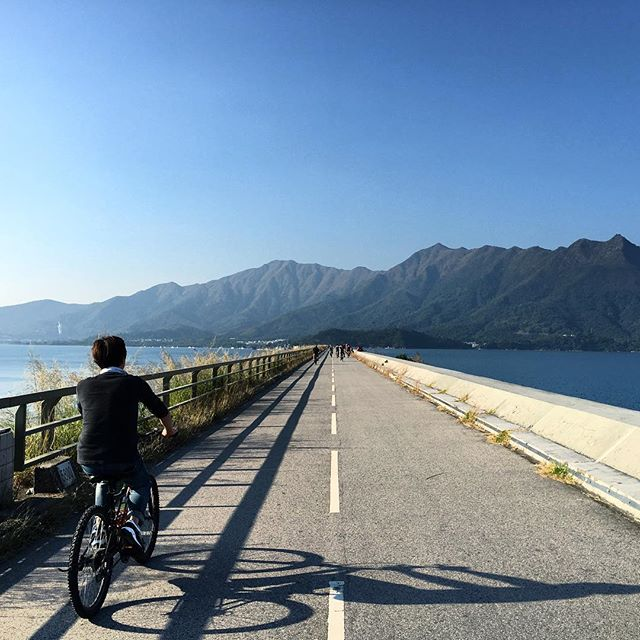 A #cyclist is #cycling across the #PloverCoveDam. #hongkong #hk #hkig #PloverCove #PloverCoveReservoir #reservoir