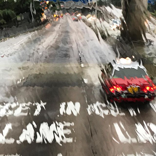 Get in Lane - a #taxi on a rainy day in #HongKong. #nofilter, the effect is from shooting through #rain streaked #bus window. #hk #hkig