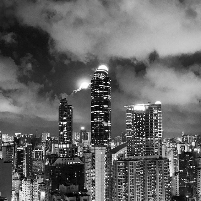 The #moon behind the #clouds on dark night in #Mongkok. #LanghamPlace looms in the background. #noir #mono #hongkong #hk #hkig